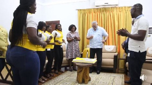 Former President Flt Lt Jerry John Rawlings in white, dancing to birthday tunes from the women