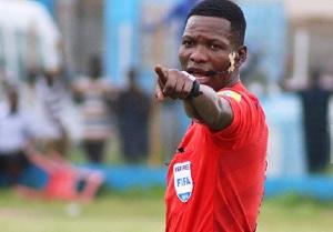 Referee Daniel Laryea