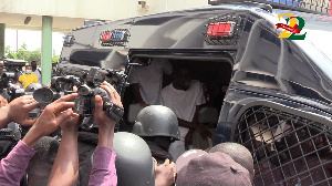 Dancehall artiste, Shatta Wale in a police van after he was granted bail