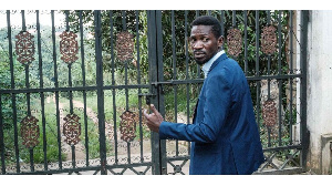 Bobi Wine, explains how uniformed personnel entered through his home's gate in Magere