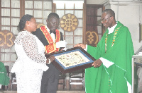 Very Rev. Fr. Samuel Filton-Mensah presenting the Papal Blessing from Pope Francis to Sir Kt Ernest