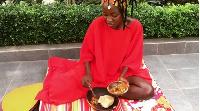 Hamamat gets ready to eat her 'Ga kenkey'