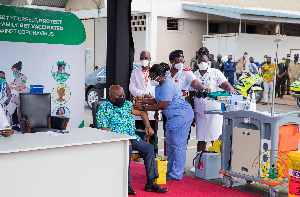 President Akufo-Addo taking his first jab of the COVID vaccine