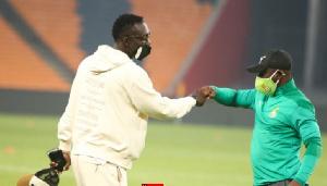 Ghana goalkeeper Richard Ofori fist-bumping a member of the technical team