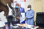 John Boadu receiving the 9-Member Committee report from Osafo Maafo