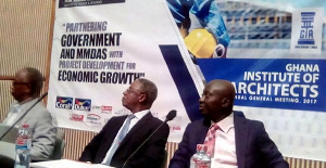 Atta Kyei (right) followed by Mr Joseph Hayford seated at the AGM