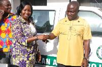 Managing Director of Zoomlion Ghana Mrs. Florence Larbi handing over the car keys to the Accra Mayor