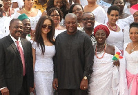 Pesident Mahama in a group photo with members of the creative industry