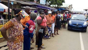 Some residents in a long queues