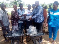 MP presenting wheel barrows to residents of Aboabo