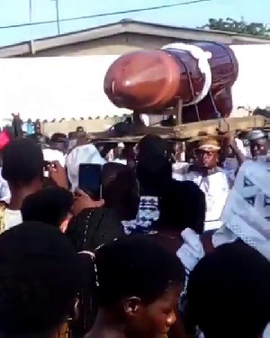 Pallbearers carrying the casket at the funeral grounds