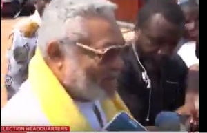 Former President Jerry John Rawlings speaks to the media after voting.