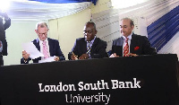Dr. Daniel Okyere Walker signing the PUC with officials of LSBU