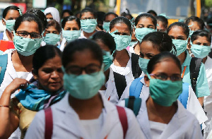 Indian nursing students wearing masks at the government-run Gandhi Hospital. Credit: Bloomberg