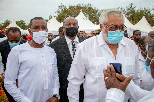 Kenpong (left in white) with the late JJ Rawlings
