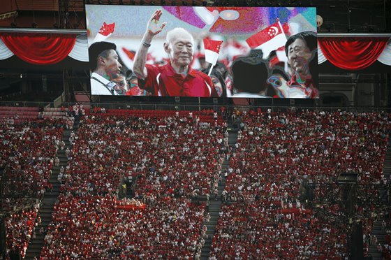 A video tribute of former prime minister Lee Kuan Yew is played during a Golden Jubilee celebration