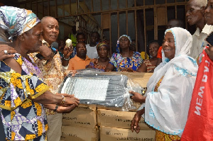 Boniface Sadique donating the street lights to the market queen