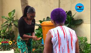 Mrs. Veronica Bekoe supervising hand washing using the Veronica Bucket