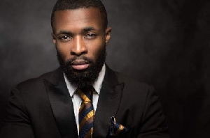 Jeffter Kwaah lives in Norway, runs a barbering shop and also works as a model