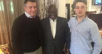 Nana Akufo-Addo flanked by Kofi Fillipo and another