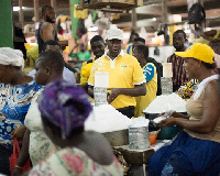 MTN staff interacting with some market women