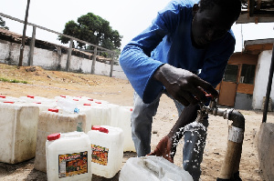 A man filling gallons with pipe water