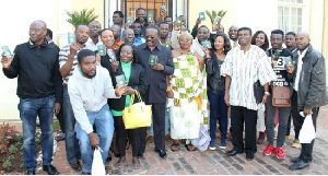 H.E. Kwesi Awhoi with Ghanaians in Pretoria showing off their new biometric passports