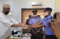 Officer Kabiru Isah receives his 100,000 naira gift