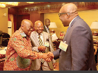 President Akufo-Addo shakes the hand of Mr Kobby Andah
