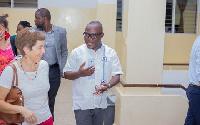 Prof Ransford Gyampo ushers Ambassador Diana Acconcia to the venue