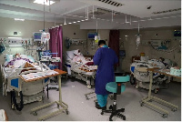 An Iranian nurse tends to patients suffering from coronavirus disease in Tehran