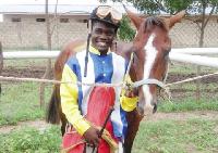 Young jockey John Adjetey with his horse.