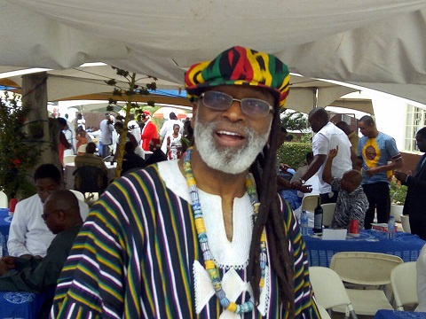 Rev. Gabriel Charles Palmer-Buckle dresses like a Rastafarian