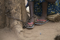 A chained mentally challenged person