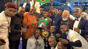 Alfred 'Bukom Bomber' Lamptey with his titles