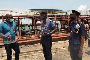 Director General Of The Authority Thomas Kofi Alonsi With Some Security Official