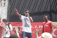Kofi Kinaata on stage at Kaneshie market