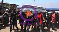 Mourners carry the casket with remains of Madam Joyce Amankwah