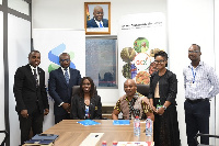 Officials of Standard Chartered Bank, Ghana Commodity Exchange after signing the MoU