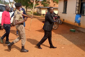 Mr Kabuleta being led to Hoima Police Station after being arrested