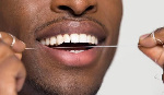 File Photo: Man flossing his teeth