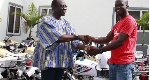 Former BOST C.E.O, Kwame Awuah-Darko handing over the motorbikes to beneficiaries