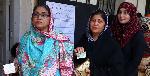 Kashmiri women living in Karachi line up to cast their votes in the legislative assembly polls
