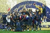France players celebrating lifting the glamorous trophy