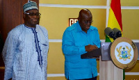 Upper West Regional Minister, Alhassan Suleman (L) and President Akufo-Addo
