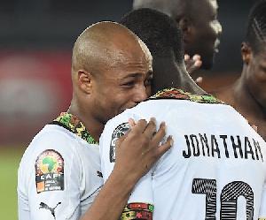File photo: Jonathan Mensah hugs Dede Ayew
