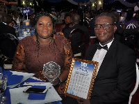 Ms. Jackie Senoo together with Mr. Prosper Gati display the award