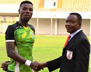 Sekondi Hasaacas defender Abeiku Ainooson (L) being congratulated by an official