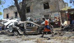 A boy walks past the site of a car bomb attack near a security checkpoint in Mogadishu