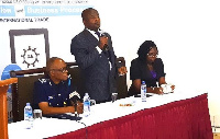 Mr Kwasi Bobie-Ansah (middle) explaining some of the functions of the GTH app at the event